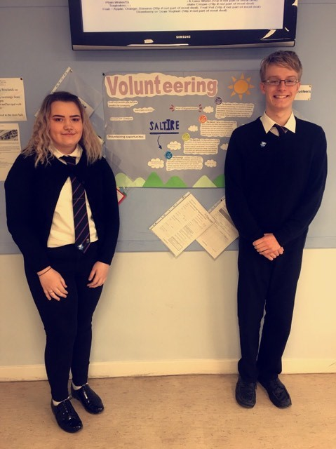caitlin and gordon by their voluntering wall